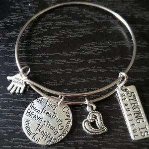 Silver adjustable charm bracelet (strong Bea)
